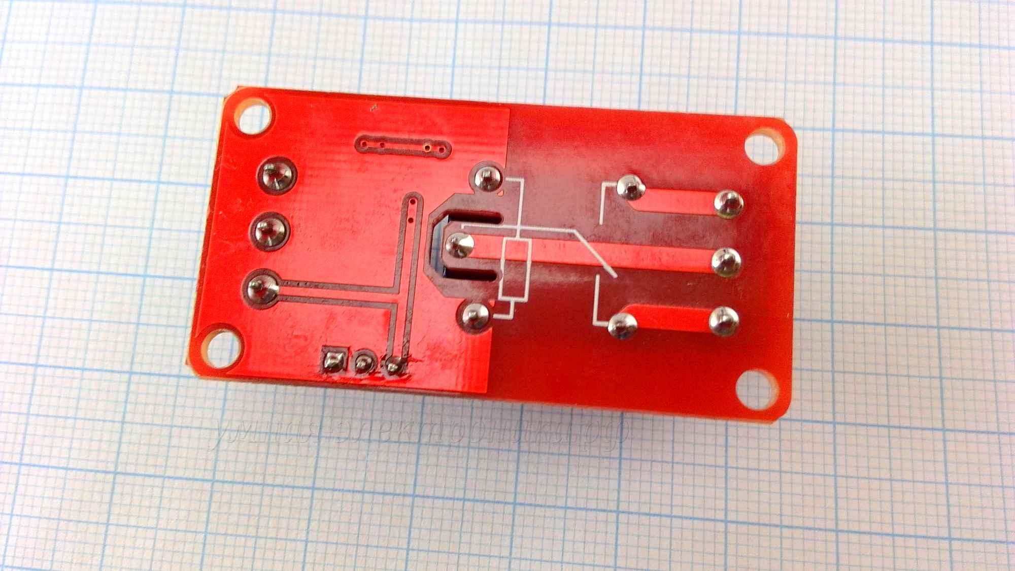 Модуль реле 12V с оптопарой и уровнем логики HL LL - вид снизу